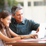 father-and-daughter-looking-at-laptop-and-discussing-security